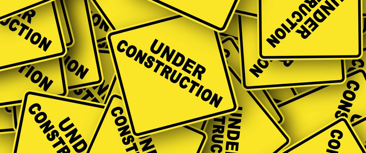 Pile of Under Construction signs