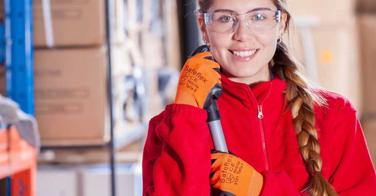 Woman wearing safety goggles and protective gloves