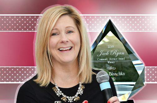 Patti Blaschka next to Community Service Award