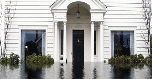 Front of a a house that is submerged in water