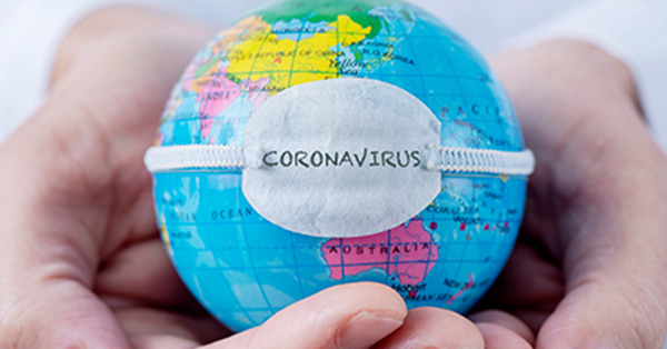 Hands holding a small globe with a band across the globe that reads Coronavirus