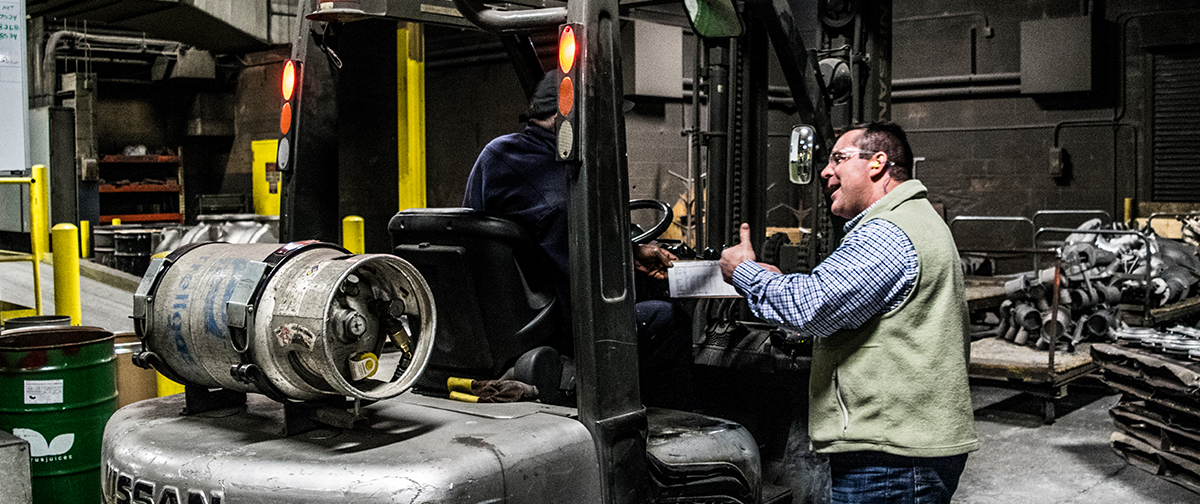 Man speaking to forklift operator