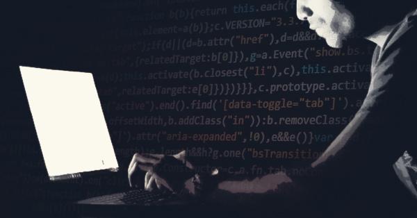 Image depicting man hacking a laptop